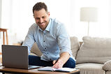young-man-going-through-paperwork-at-hom