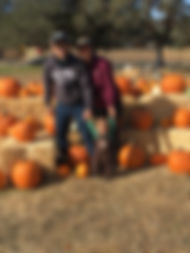 happy family at pumpkin patch.jpg