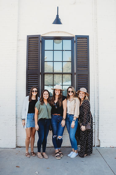 LEO + LAINE Creative Marketing Agency_the LEO + LAINE team in Waco, Texas in front of a bakery at Magonila Silos