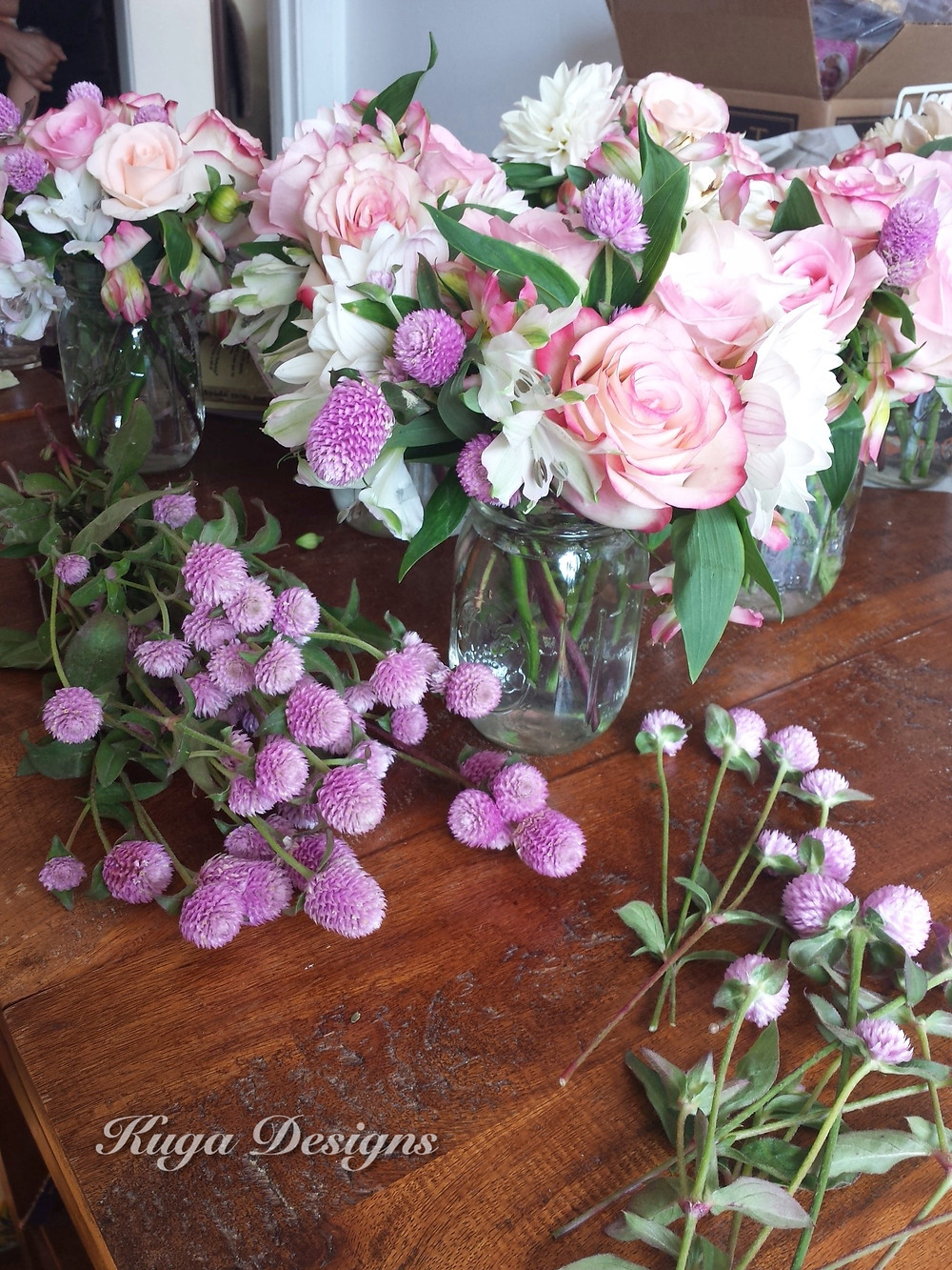Pink and white flowers in mason jars centerpiece