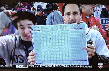 Baseball by the Numbers scorebooks at a major league game