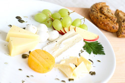 Cheese with berries or grapes