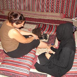 Me getting henna painted on my ankle