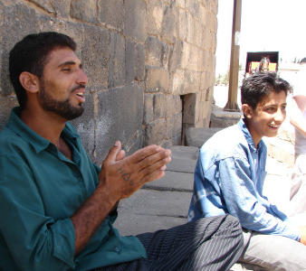 Man singing with his family, Bosra