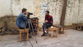 Morton interviewing Kareem, a Syrian ref