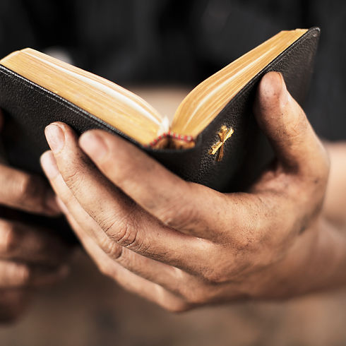 Man holding a bible.jpg