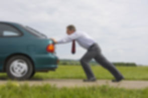 Businessman pushing a car with empty fue