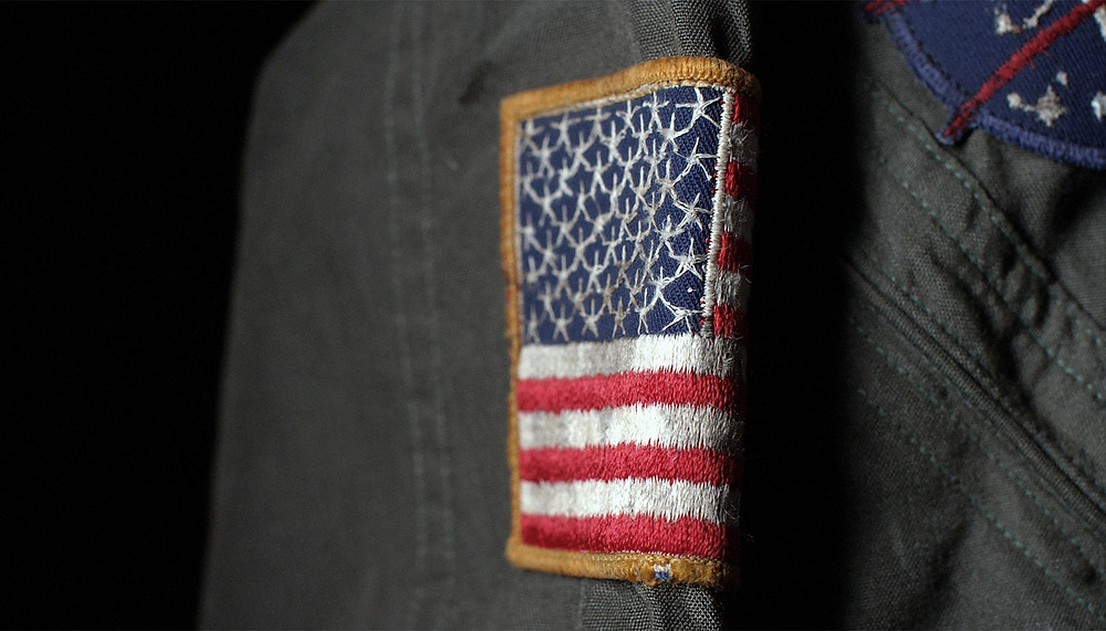 U.S. flag patch on actual flight suit worn by Apollo 18 astronaut Al Borden in the Takla Makan Desert, China, June 1973
