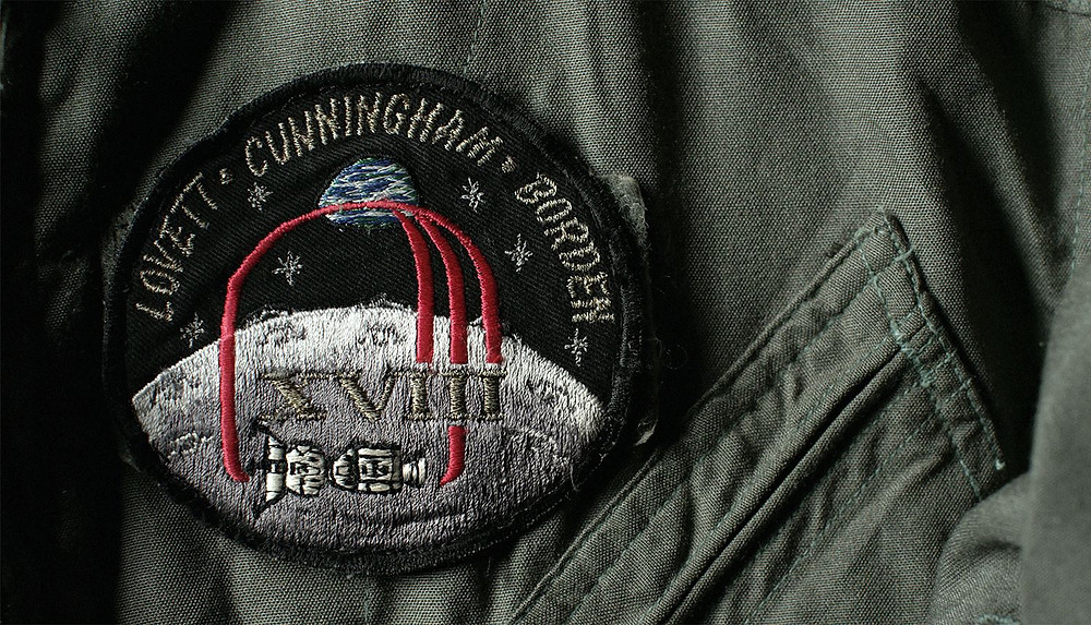 Apollo 18 mission patch on actual flight suit worn by Apollo 18 astronaut Al Borden in the Takla Makan Desert, China, June 1973
