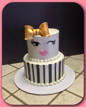 Gold bow tiered cake