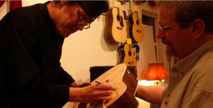 steve signs guitar.jpg