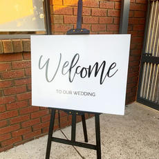 White 'Welcome' sign
