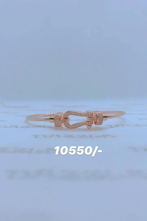 Silver horseshoe bangle with rosegold plating