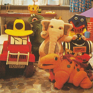 Diesel the Truck, Alfred the Green Hot water Bottle, Johnson the Pink Elephant, Mcduff the Concertina, Squeaky the Robot, Victoria the Dinosaur