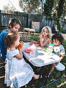children eating lunch outside daycare
