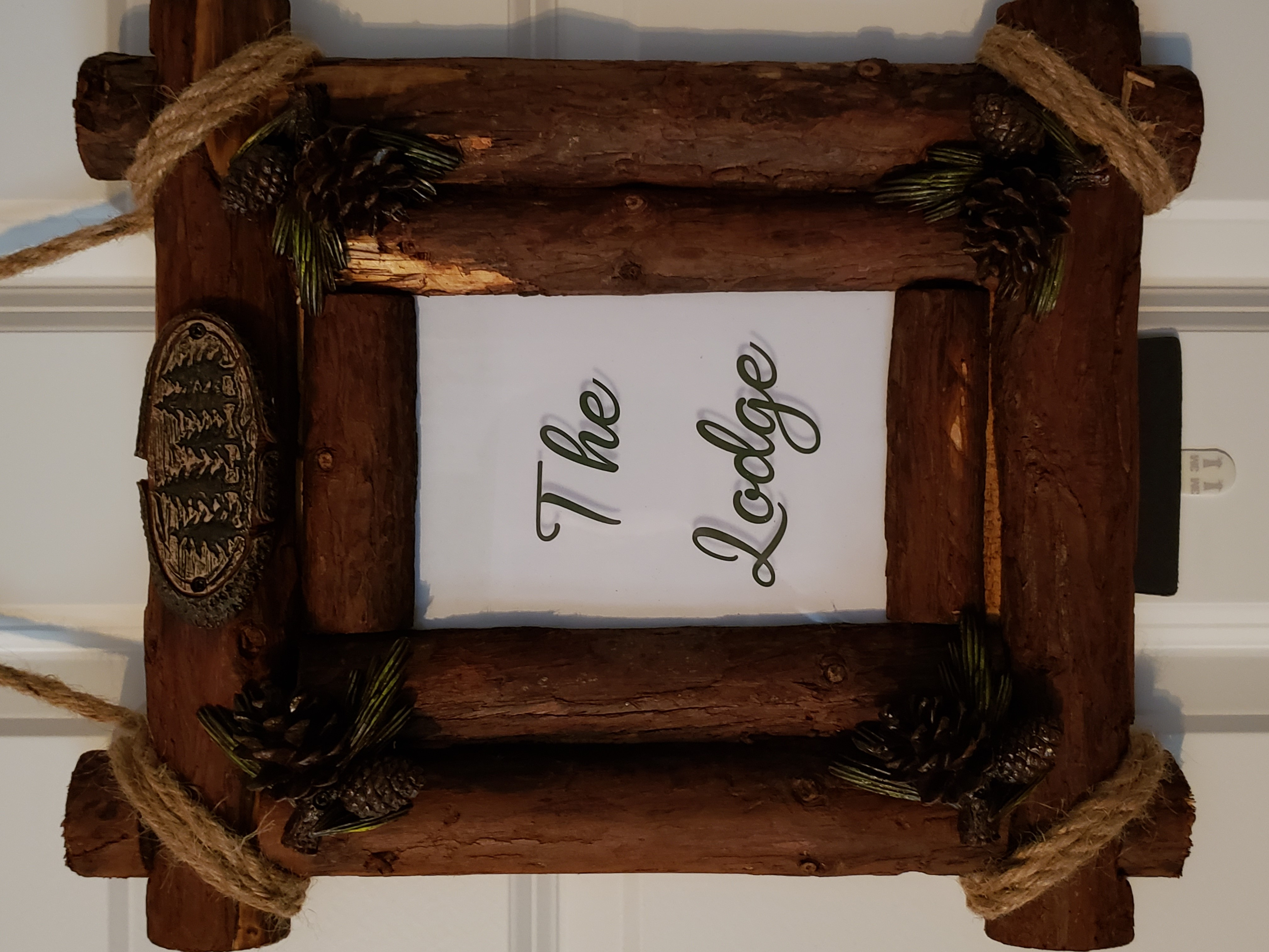 Framed door sign for The Lodge