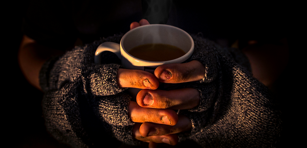 Homeless person with hot drink.png