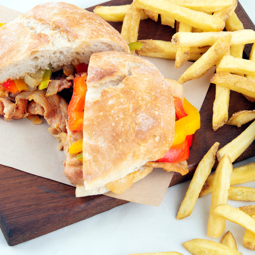 Bifana sandwich with bell pepper and onion topping takeaway hot sandwich.jpg