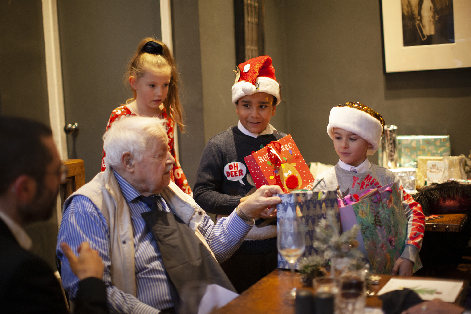 Kids deliver presents to elderly