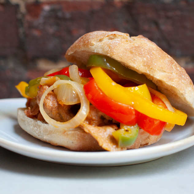 Bifana with pepper and onion topping Go Bifanas Norwich Takeaway.jpg