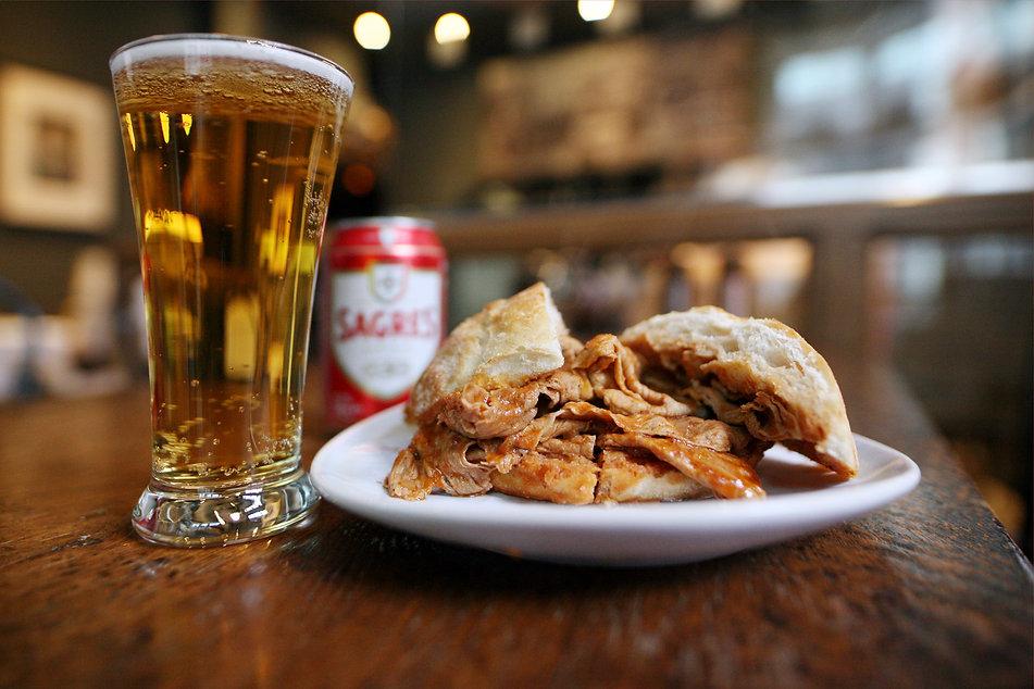takeaway juicy bifana sandwich  and portuguese beer.jpg