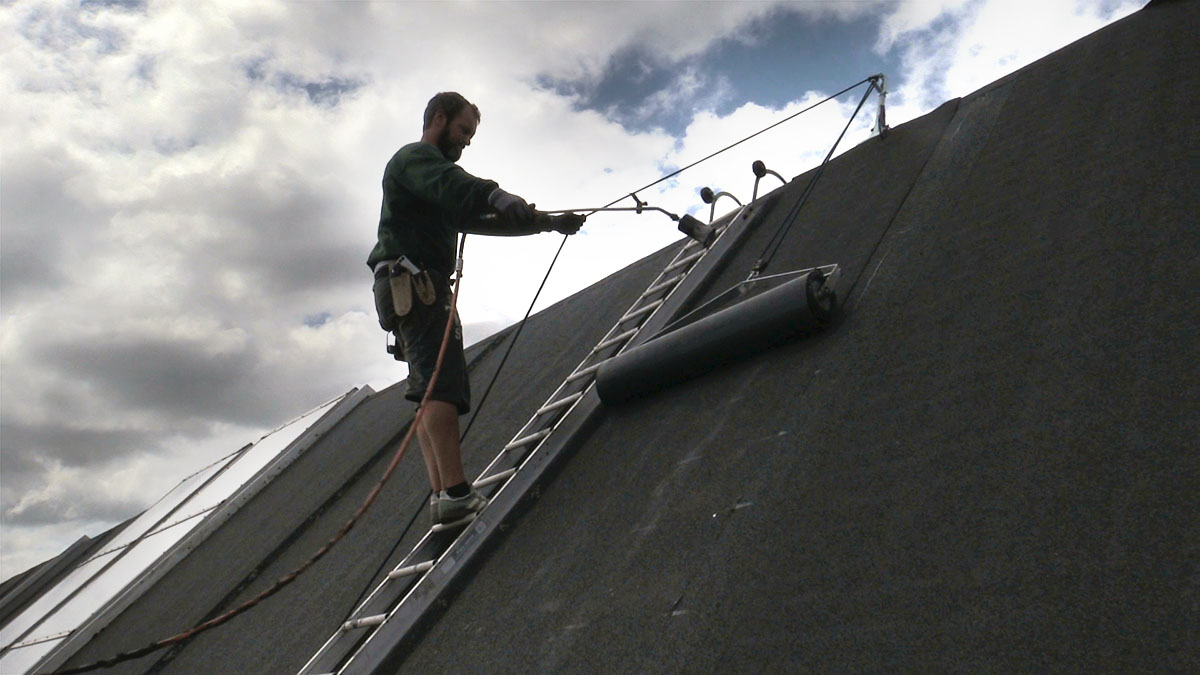 Slope system - applying tar rool to roof