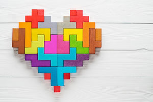 Heart made of colorful wooden shapes, to