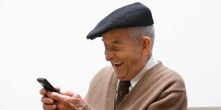 old man laughing holding cellphone