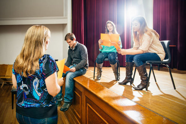 High school students rehearse onstage