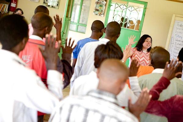 Ali leads teachers in a workshop training