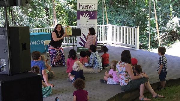 Artistic Director Ali Oliver-Krueger reads to children at Strathmore's Backyard Theatre