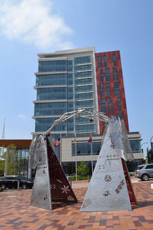 """The Maryland-National Park and Planning Commission [M-NCPPC] Wheaton Headquarters on Reedie Drive (""""Meet Me at the Triangles"""" sculpture in foreground)"""