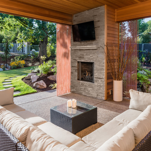 Beautiful covered porch and stone fireplace