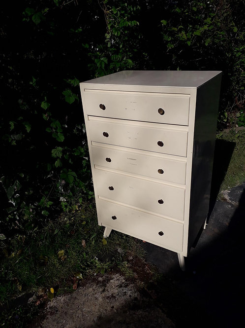 Utilitarian small chest of drawers