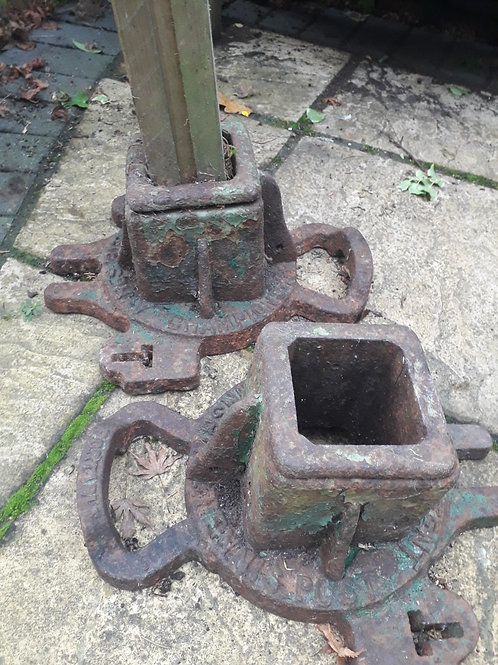 A pair of old iron tennis post stands