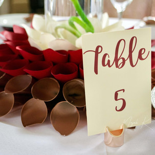 TABLE NUMBERS AND CENTERPIECES.jpg