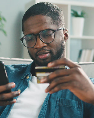 African young man in glasses shopping on