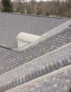Shingle roof with metal dorms