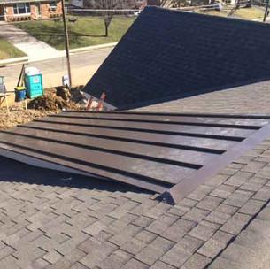 Metal and shingle roof