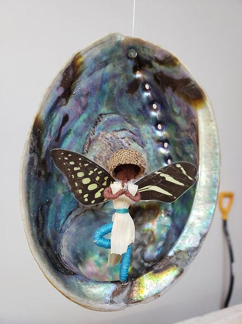 The tree pose fairy inside a Paua shell