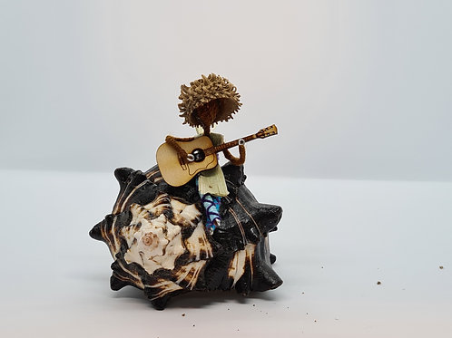 Surfer and guitar on a shell for Krissy