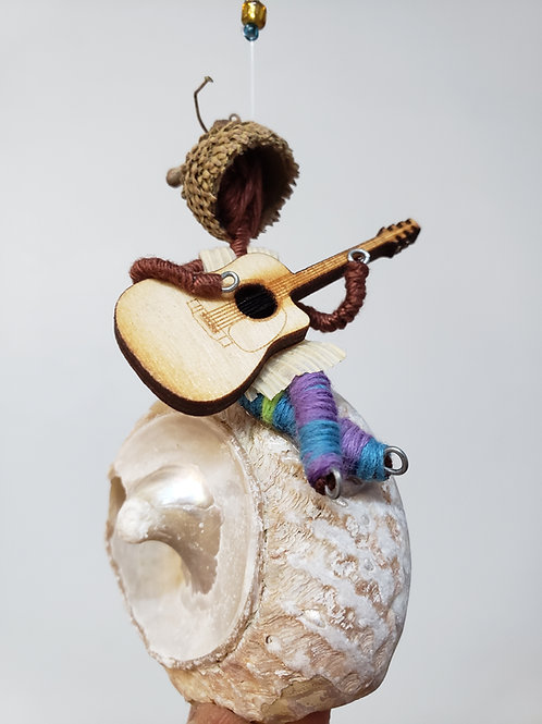 Guitar player on a shell