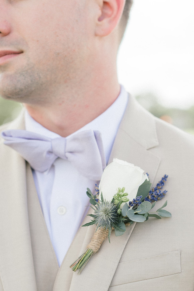 white-and-lavender-boutonniere.jpg