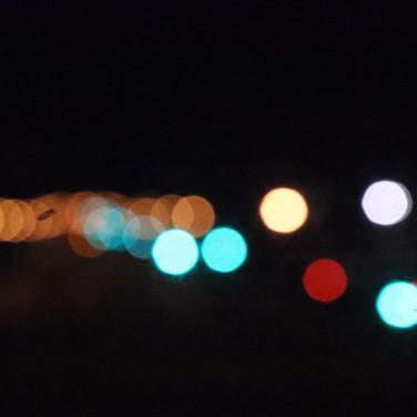 City lights from the the van window.