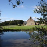 Slate Rigg Farmhouse from pond