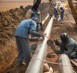 Workers laying gas pipelines