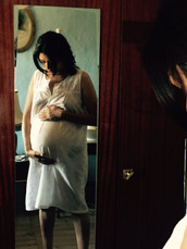 Behind the pregnant scene