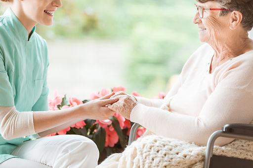 nurse-preparing-a-disabled-pensioner-for