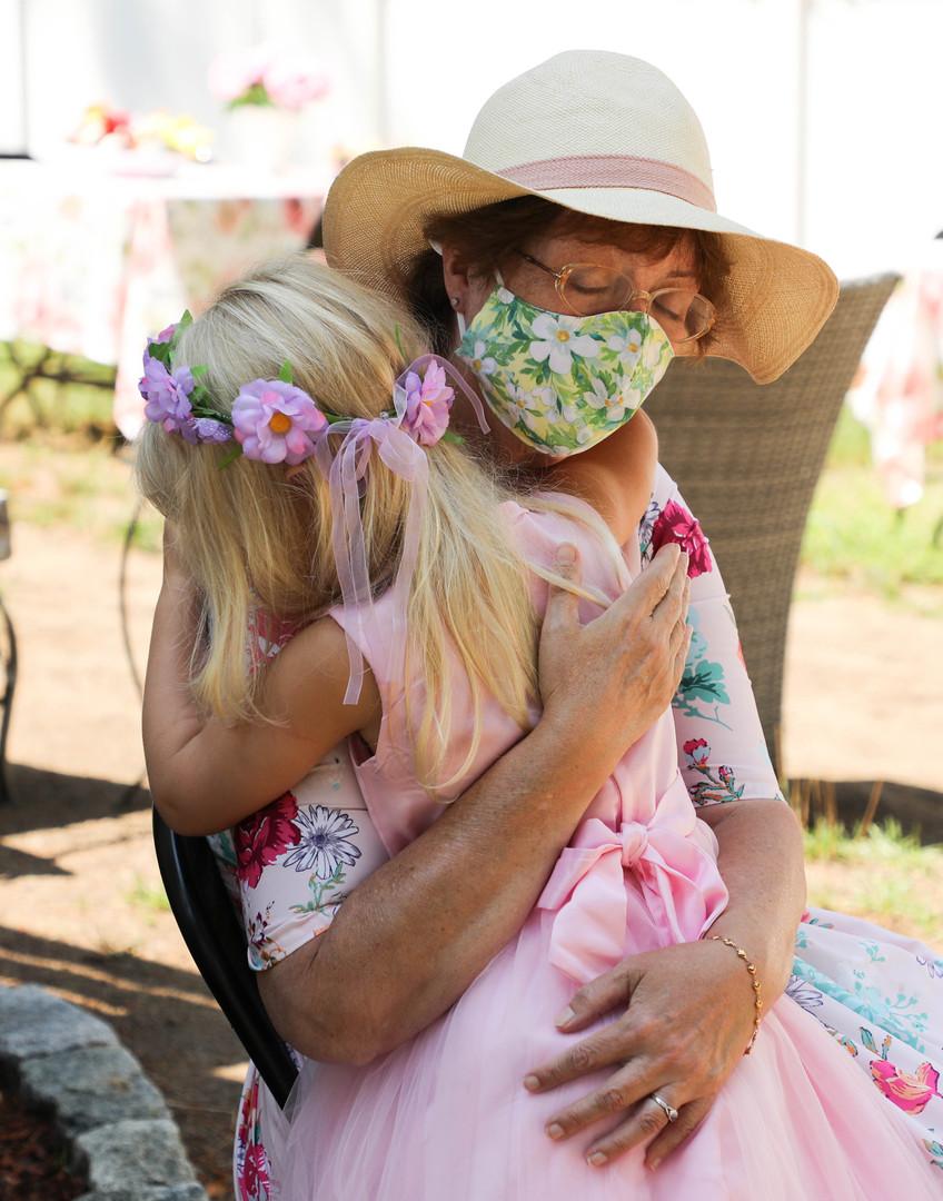 A masked hug from Nana