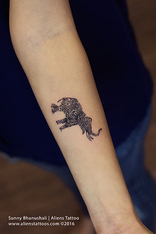 Elephant with Thumb Print Tattoo